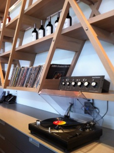 A turntable and a large record collection are part of the experience at Culmina.
