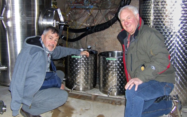 Paul Gardner, left, and Dr. Dick Jones check on small tanks at Pentâge Winery that contain samples of the 2015 Pinot Gris being used to test Jones' ground-breaking new CO₂ scrubbing process.