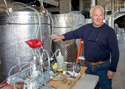 Dr. Dick Jones explains his wine CO2-scrubbing process during a recent experiment with Pinot Gris at Pentâge Winery.